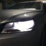 VW Passat B7 Osram H7 LEDriving Gen2 low beam + T10 LED position bulbs close up
