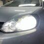 VW Golf VI with Osram Night Breaker LED H7 64210DWNB low beam + adapters 64210DA07 + LED W5W position bulbs close up 2